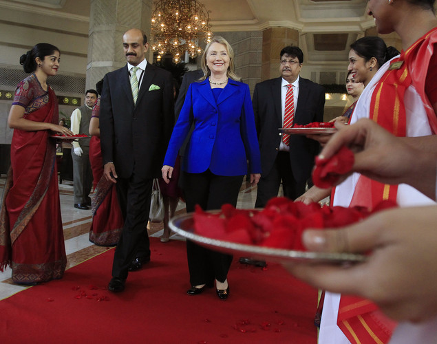 U.S. Secretary of State Hillary Rodham Clinton leaves the Taj Hotel in Kolkata.