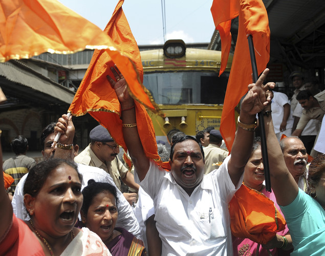 Shiv Sena party workers shout slogans as they protest on a railway track during a nationwide strike in Mumbai.