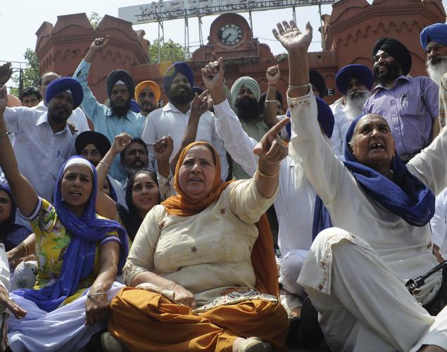 Shiromani Akali Dal (SAD) activists shout slogans against UPA chairperson and All Indian Congress Committee (AICC) president Sonia Gandhi during a strike against a petrol price hike in Amritsar.