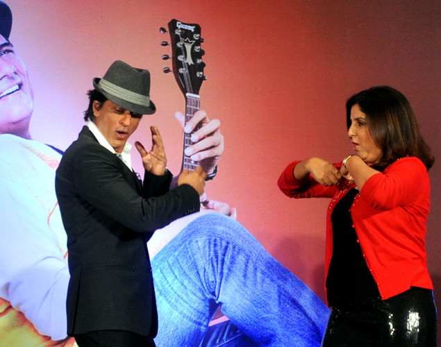 Bollywood film actors Shahrukh Khan (L) and Farah Khan pose during the third teaser poster and music launch of the forthcoming Hindi film 'Shirin Farhad Ki Toh Nikal Padi' directed by Bela Bhansali Sehgal in Mumbai.