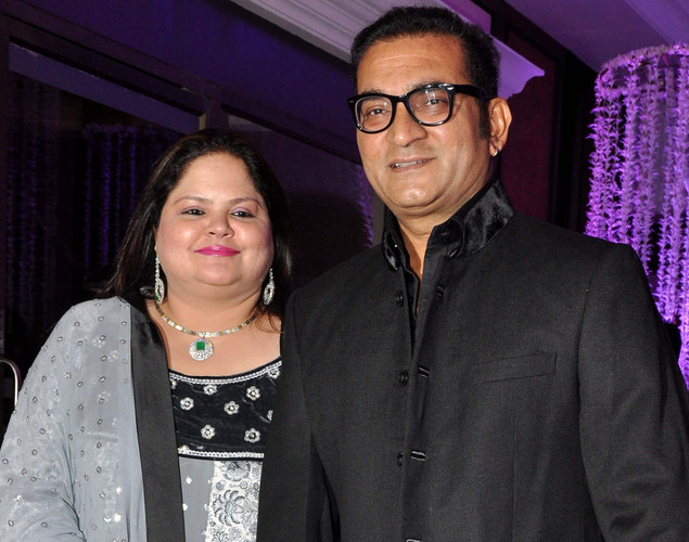 Indian Bollywood playback singer Abhijeet Bhattacharya and his wife attend the wedding reception of playback singer Sunidhi Chauhan and musician Hitesh Sonik.