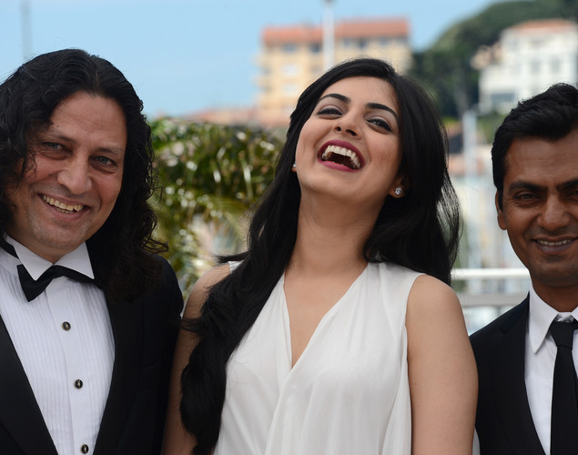 Anil George, Niharika Singh and Bollywood actor Nawazuddin Siddiqui pose during the photocall of 'Miss Lovely' presented in the Un Certain Regard selection at the 65th Cannes film festival.