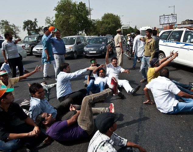 Bharatiya Janata party (BJP) activists shout anti-UPA government slogans as they block a road during a protest against a petrol price hike in New Delhi.