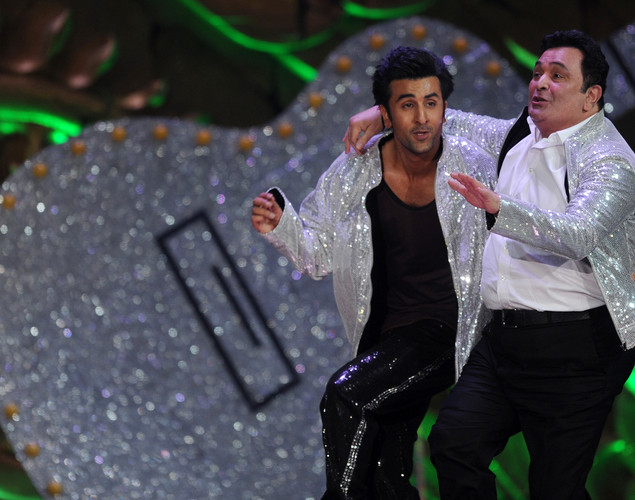 Bollywood actor Ranbir Kapoor (L) performs with his father and veteran actor Rishi Kapoor on the stage during the International Indian Film Academy (IIFA) awards ceremony in Singapore.