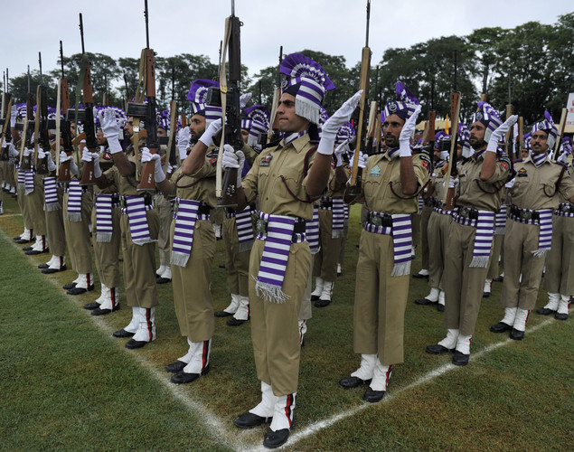 Jammu and Kashmir Armed Police (JKAP) present arms during celebrations marking India's Independence Day at The Bakshi Stadium in Srinagar on August 15, 2012.