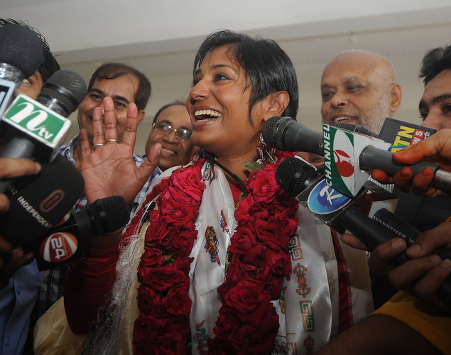 Bangladeshi mountaineer Wasfia Nazreen (C) speaks with reporters after arriving at the Hazrat Shahjalal International Airport in Dhaka.