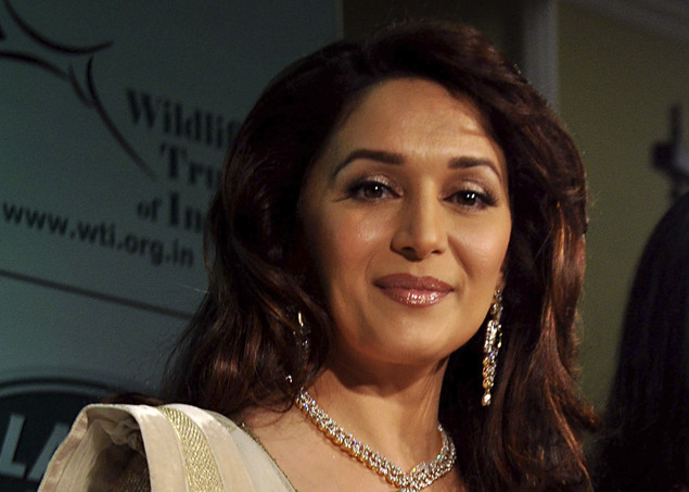"Indian Bollywood actress Madhuri Dixit looks on during the Gemfields ""Emeralds for Elephants"" event in Mumbai  July 20, 2011."