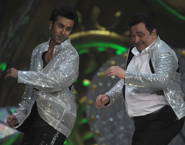 Bollywood star Ranbir Kapoor (L) performs with his father and veteran actor Rishi Kapoor on the stage during the International Indian Film Academy (IIFA) awards ceremony in Singapore.