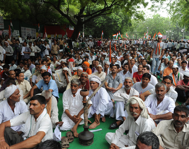 Supporters of anti-corruption activist Anna Hazare gather for a rally where Hazare began his hunger strike in New Delhi.