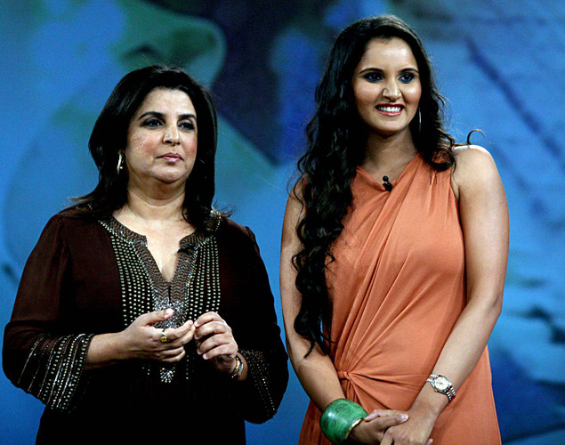Indian tennis player Sania Mirza (R) and choreographer Farah Khan on the set of NDTV's television show 'Issi Ka Naam Zindagi' in Mumbai.