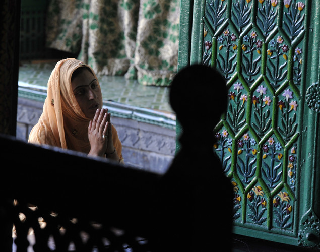 A Kashmiri Muslim woman prays at the Shah-i-Hamdaan shrine during Ramadan in Srinagar.