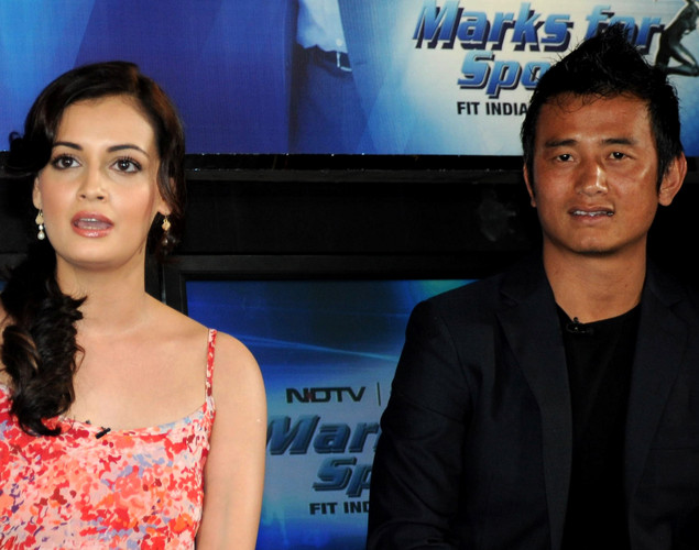 Bollywood film actress Dia Mirza and Indian football player Baichung Bhutia pose during the launch of the 'Marks For Sports' campaign created by the Fit India Movement in Mumbai.