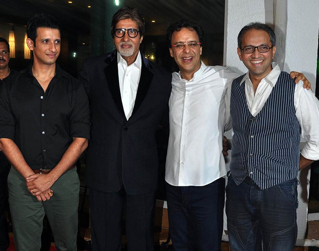 "Bollywood actors (L-R) Sharman Joshi, Amitabh Bachchan, producer Vidu Vinod Chopra, and director Rajesh Mapuskar pose during a party for the Hindi film ""Ferrari Ki Sawaari"" in Mumbai."