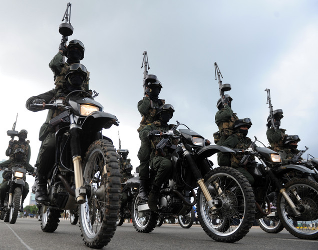 Sri Lankan Specials Forces personnel ride in formation during a parade rehearsal in Colombo.