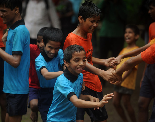 Indian visually impaired children take part in celebrations on the eve of 'Janmashtami', which marks the birth of Hindu God Lord Krishna by breaking a dahi-handi, curd-pot suspended in the air, at the Victoria School for the Blind in Mumbai on August 9, 2012 .