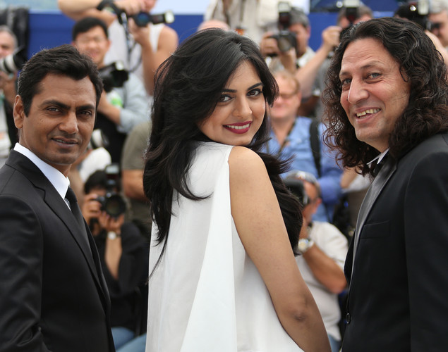 Nawazuddin Siddiqui (L), Niharika Singh (C) and Anil George pose during the photocall of 'Miss Lovely' presented in the Un Certain Regard selection at the 65th Cannes film festival.