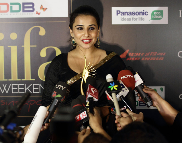 Vidya Balan speaks to the media backstage after she wins the Best Actress award for her role in The Dirty Picture at the 2012 International India Film Academy Awards at the Singapore Indoor Stadium.