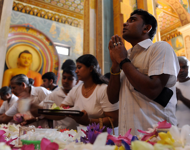 Sri Lankan devotees pray at a Buddhist shrine in observation of Vesak in Colombo.
