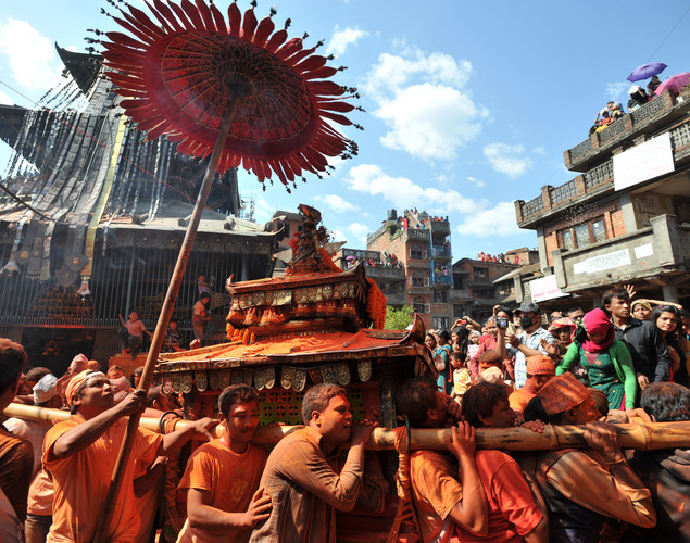 Nepalese revellers carry chariots of Hindu gods and goddesses during The Bisket Jatra Festival at Thimi on the outskirts of Kathmandu.
