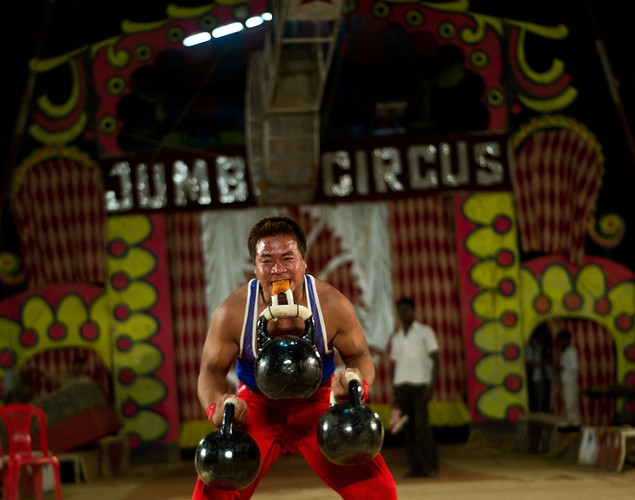 A performer lifts weights with his teeth at the Jumbo Circus in Gurgaon,.