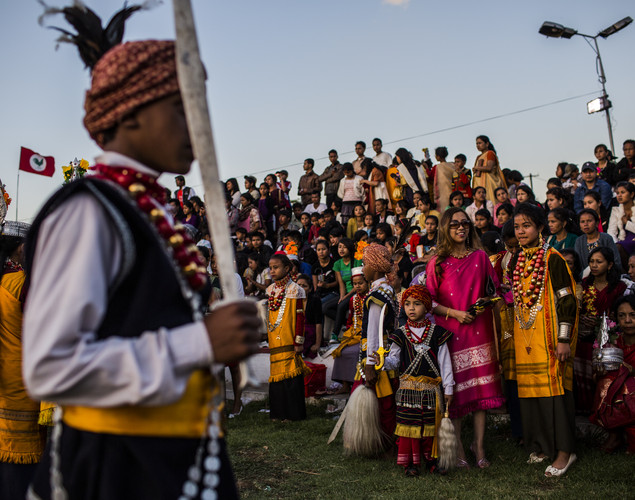 Familiy and friends of Tribal Khasi maidens, watch from the stands during the Shad Suk Mynsiem Festival.