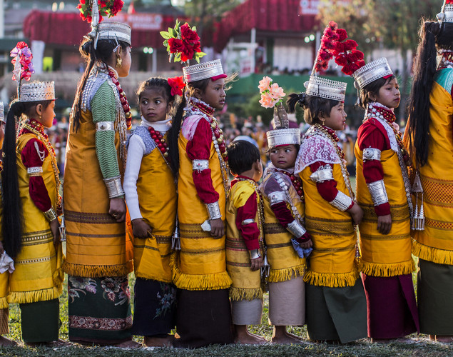 Tribal Khasi maidens dressed in traditional costume participate in dance during the Shad Suk Mynsiem Festival.