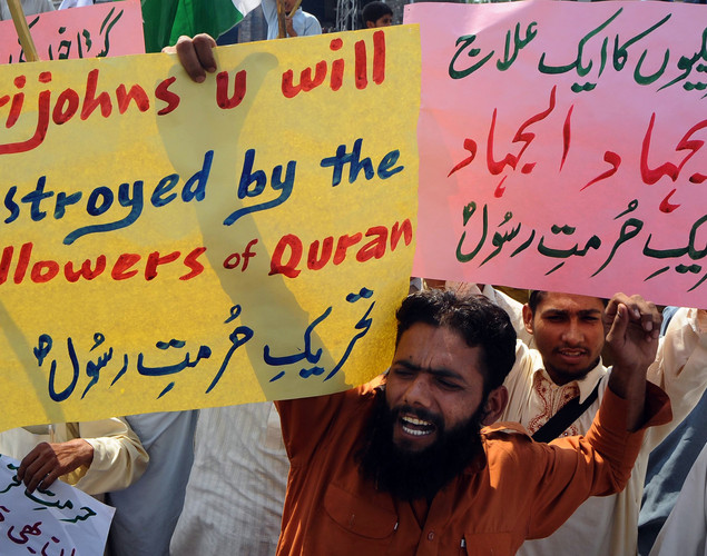 Supporters of Pakistan's outlawed Islamic hardline Jamaat ud Dawa (JD) group shout slogans against United States pastor Terry Jones, over the recent burning of the Koran by Jones at his Florida church, in Lahore.