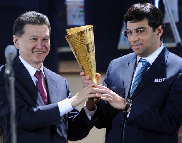 India's defending World chess champion Viswanathan Anand (R) receives an award from International Chess Federation President Kirsan Ilyumzhinov during the award ceremony of the FIDE World chess championship match in State Tretyakovsky Gallery in Moscow.