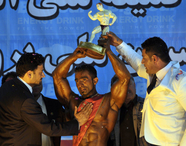 Afghan bodybuilder, Mohammad Yousuf Sakhi, lifts a trophy after he won the Mr. Afghanistan nation wide bodybuilding competition in Kabul. Bodybuilding is one of the country's most popular sports, even permitted during the 1996-2001 Taliban regime.