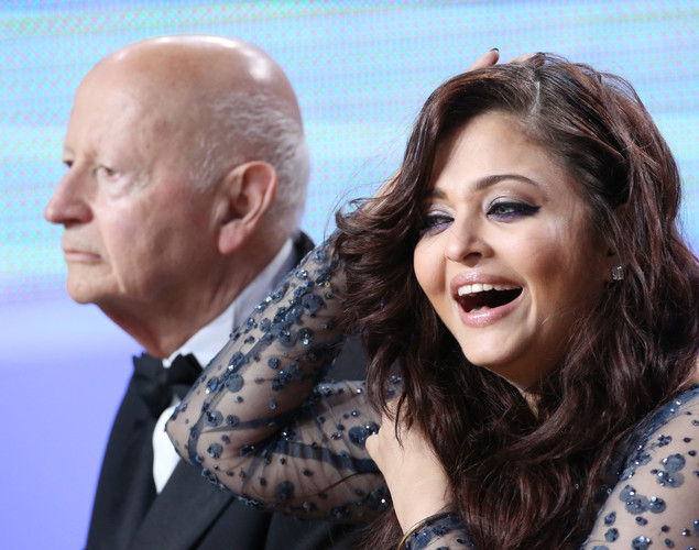 Indian actress Aishwarya Rai and the president of the Cannes Film Festival Gilles Jacob take part in the TV show 'Le Grand Journal' on the set of French TV Canal+ during the 65th Cannes film festival.