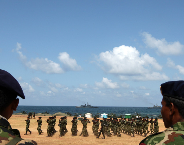 Sri Lankan military officers march during military parade rehearsals in preparation for the celebration of the third anniversary of the end of the civil war and the defeat of the separatist Tamil Tiger rebels.