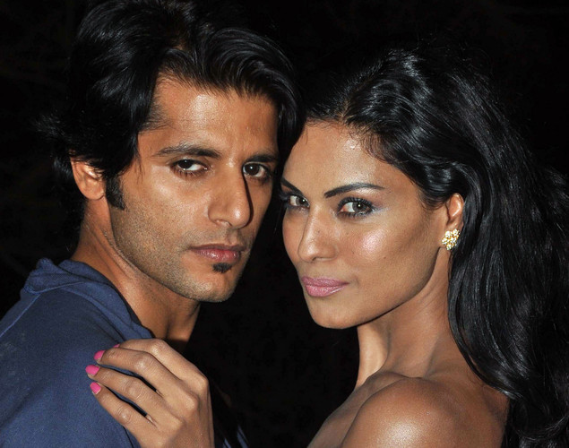Pakistani actress Veena Malik (R) and Bollywood actor Karanvir Bohra (L) pose on the set of their forthcoming Hindi film Mumbai 125 kms in Mumbai on March 21, 2012.