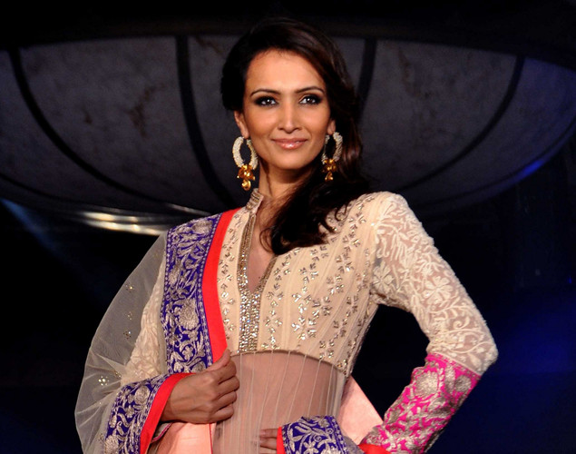 Dipannita Sharma displays a creation by designer Manish Malhotra for a public awareness campaign 'Save and Empower the Girl Child' in Mumbai.