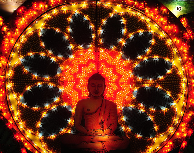 A lit display featuring a seated Buddha is pictured during the annual Buddhist festival of Vesak in Colombo.