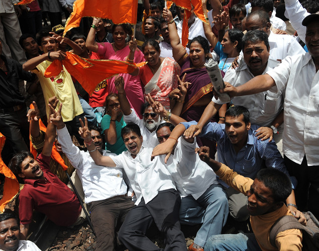 Indian Shiv Sena party workers shout slogans as they protest on the railway track during a nationwide strike in Mumbai.