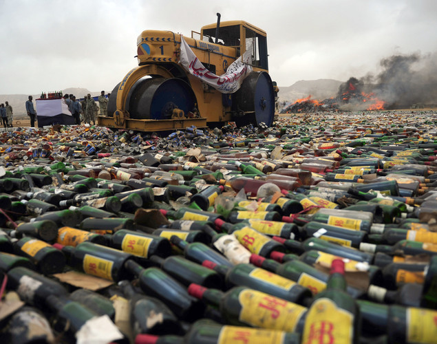 A Pakistani official uses a steamroller to crush bottles of liquor during a ceremony to mark International Day against Drug Abuse and Illicit Trafficking, in Karachi.