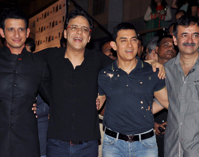 Bollywood film actor Sharman Joshi, (L), producer Vidhu Vinod Chopra, (2L), actor Aamir Khan (2R) and director Rajkumar Hirani pose during the premiere of Hindi film 'Ferrari Ki Sawaari' in Mumbai.