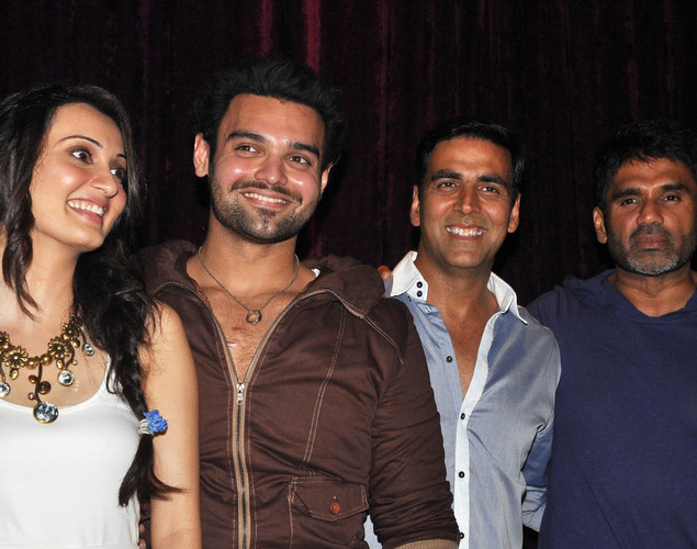 "Vaishali Desai (L), Mahaakshay Chakraborty (2L) and their guests Akshay Kumar (2R) and Suniel Shetty (R) pose for a photo during the launch of upcoming Hindi film ""Tukkaa Fitt"" directed by Shawn Arranha in Mumbai."