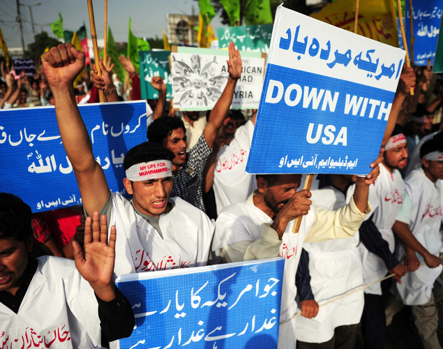 Pakistani Muslims hold banners and shout anti-US slogans during a rally against an American produced film mocking Islam on September 16, 2012 in Karachi.