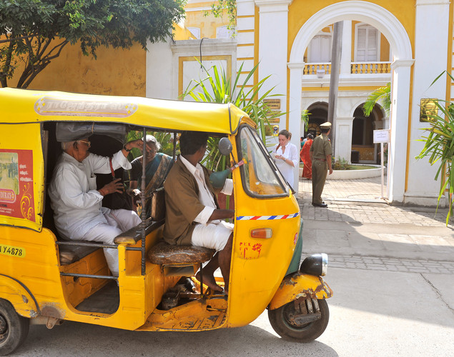 96-year-old Srinivasan (L), an Indo-French citizen enters an autorickshaw after casting his vote during the first round of French presidential elections held in Pondicherry.