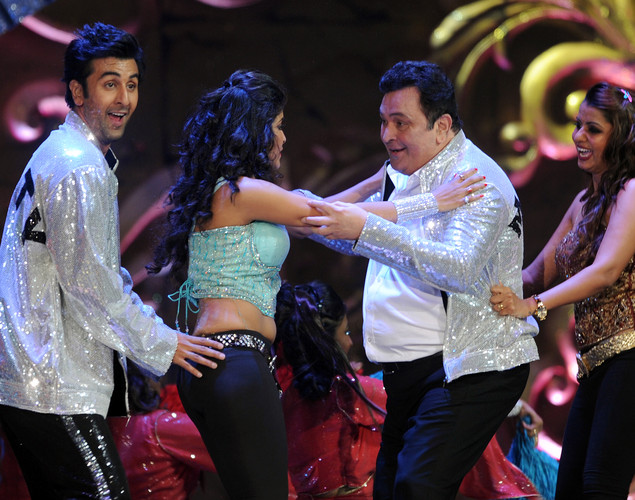 Bollywood star Ranbir Kapoor (L) performs with his father and veteran actor Rishi Kapoor (2nd R) and other dancers on the stage during the International Indian Film Academy (IIFA) awards ceremony in Singapore.