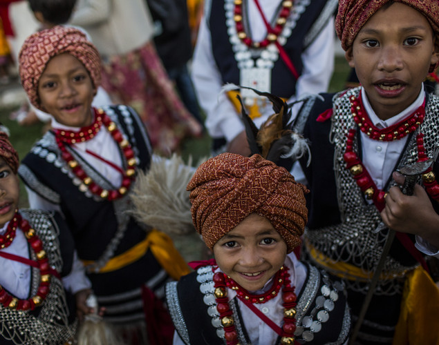 Tribal Khasi boys dressed in traditional costume pose for a photograph during the Shad Suk Mynsiem Festival.