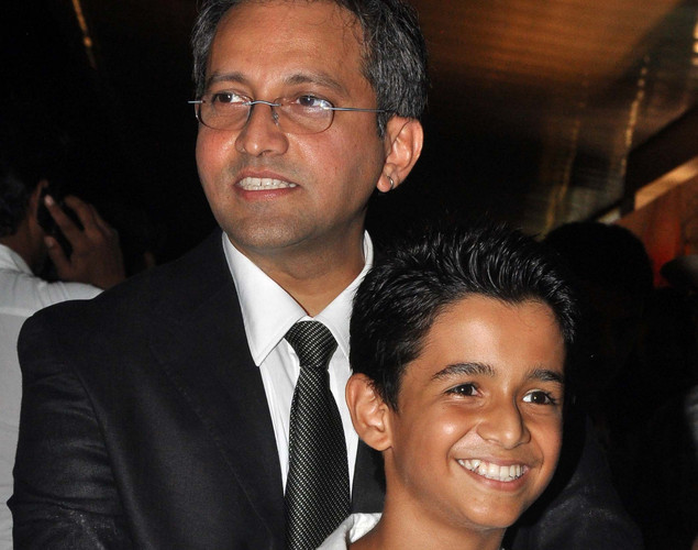 Bollywood child actor Ritvik Sahore (R) and director Rajesh Mapuskar pose during the premiere of Hindi film 'Ferrari Ki Sawaari' in Mumbai.