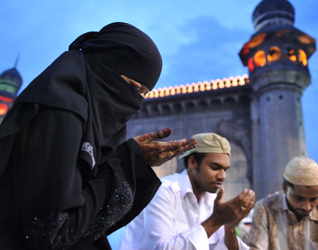 Indian Muslims offer prayers prior to breaking their fast on the first day of the month of Ramadan at Mecca Masjid in Hyderabad.
