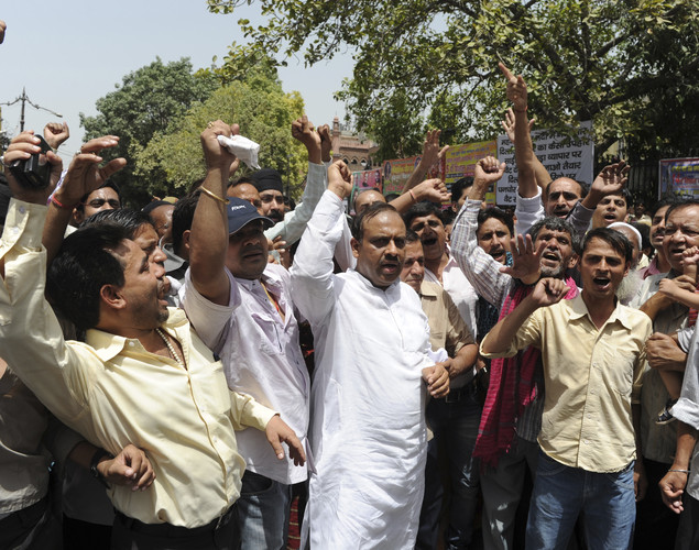 Bharatiya Janata Party (BJP) leaders and supporters shout anti-goverment slogans during a protest in the old quarters of New Delhi.