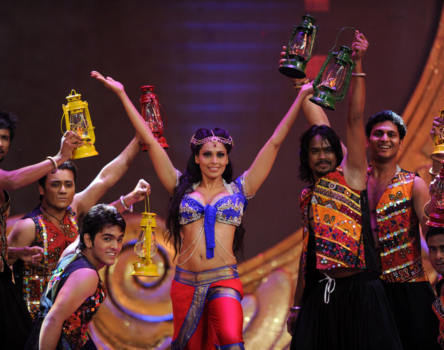 Bollywood actress Bipasha Basu (C) performs on the stage during the International Indian Film Academy (IIFA) awards ceremony in Singapore.