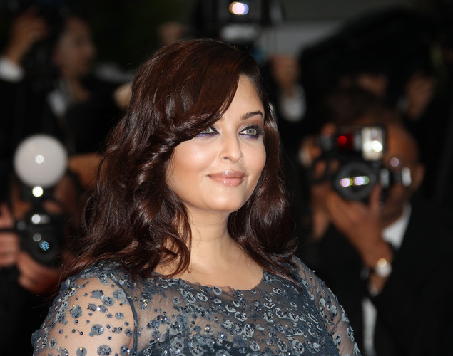 Indian actress Aishwarya Rai poses as she arrives for the screening of the film 'Cosmopolis' presented in competition at the 65th Cannes film festival.