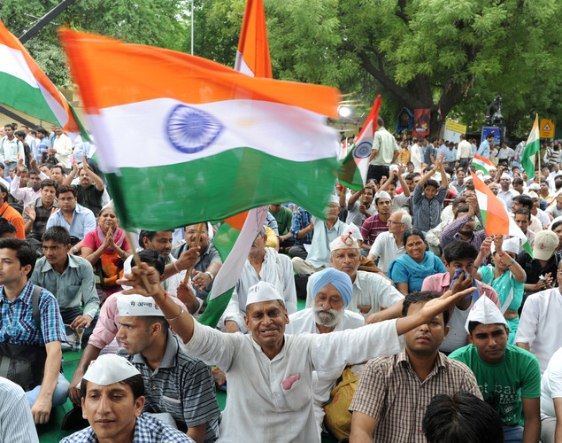 Indian supporters of anti-corruption activist Anna Hazare wave the national flag during a protest in New Delhi.