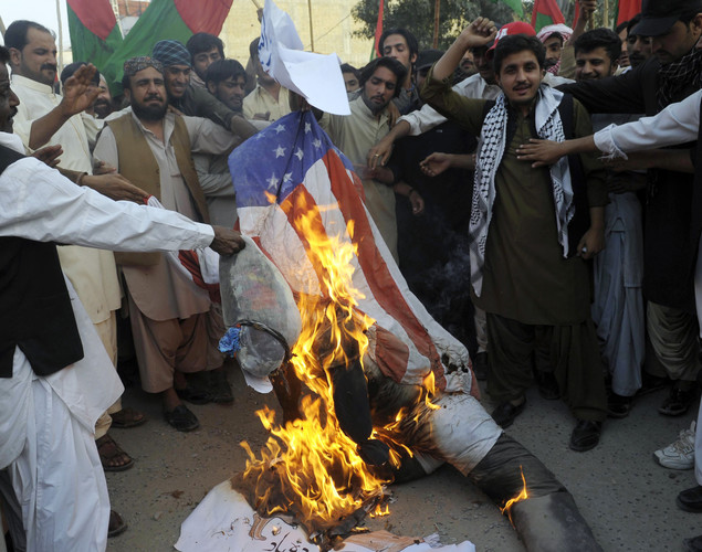 Pakistani Muslim protesters torch a US flag and an effigy of the US President Barack Obama during a rally against an anti-Islam movie in Quetta.