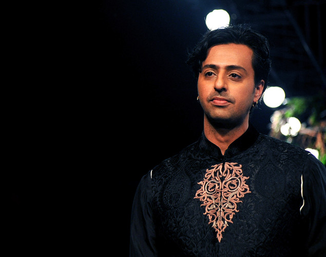 Bollywood singer and music director Salim Merchant walks the ramp for designer JJ Valaya during the Grand Finale of Aamby Valley India Bridal Fashion Week 2012 in Mumbai.